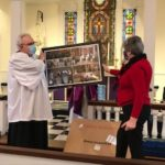 Chris and husband Jamie Green view framed photos  from her tenure  at Christ Church.